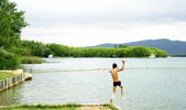 Child jumping to Bañolas's lake — Stock Photo