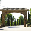 Arched entrance to a residential area - ストック写真