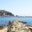 Panoramic of port of Sant Feliu de Guixols from of the beach — Stock Photo