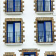 Royalty-Free Stock Photo: Front of balconies and blue windows