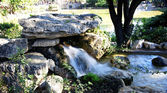 Source waterfall in a park — Stockfoto