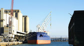 Freighter in the harbor — Stock Photo