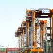 Row portico cranes — Stock Photo
