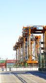Row portico cranes — Stock Photo