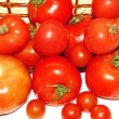 Basket of tomatoes on white background — Stock Photo