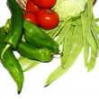 Basket of red, green peppers, tomatoes and green beans on white background — Stock Photo #30483195