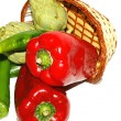 Basket of red, green peppers, tomatoes and green beans on white background — Stock Photo #30483337