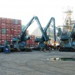 Stock Photo: Cranes and cargo at port