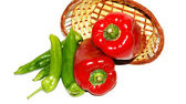 Basket of red and green peppers on white background — ストック写真