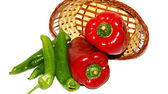 Basket of red and green peppers on white background — Stockfoto