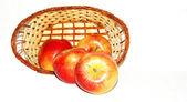 Basket of apples on white background — Stock Photo