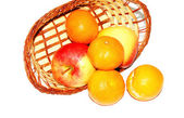 Basket of apples and tangerines on white background — Stock Photo