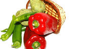 Basket of red, green peppers, tomatoes and green beans on white background — Stock Photo