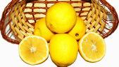 Basket of lemons on white background — Stock Photo