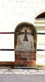 Pilar with rail and Teutonic cross in the Hospital de Sant Pau — Stock Photo