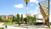 Gardens, pond and sculptures of wood and glass in Plaça de Ca N'Enseya — Stock Photo