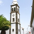 Bell tower of the church of San Ginés in Arrecife — Stock Photo #30577209