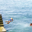 Children bathing in Arriate port — Stock Photo #30708111