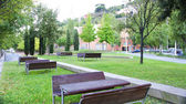 Tables and benches in Meridiana City — Stock Photo