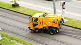 Truck cleaning trolley tracks — Stock Photo
