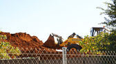 Excavator on mound of dirt — Stock Photo