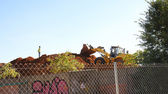 Excavator on mound of dirt — ストック写真