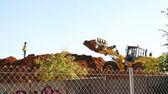 Excavator on mound of dirt — Stock Photo