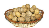 Wicker basket with walnuts — Stock Photo