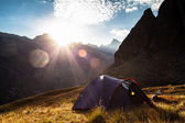 Sunrise in the mountains and the tent — Stock Photo