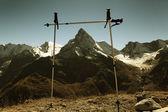 Cinema in the mountains through trekking sticks — Stock Photo