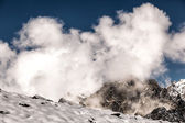 White clouds in the rugged mountains of the Caucasus — Stock Photo