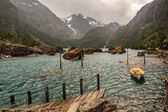 Lonely boat on the lake in the harsh mountains — Stock Photo