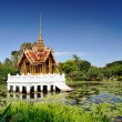 Stock Photo: Thai pavilion in lotus pond at partly cloudy , SuLuang RamI