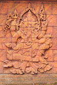 A stone carved sculpturee statue of an Indian god. — Stock Photo