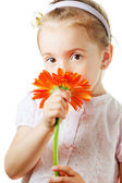 Pretty little girl with flower — Stock Photo