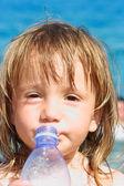 Drinking baby girl — Stock Photo