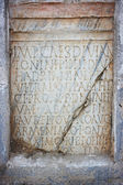 Latin text in stone — Stock Photo