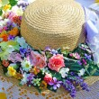 Summer hat on a summer table — Stock Photo