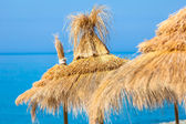 Straw umbrella hats — Stock Photo