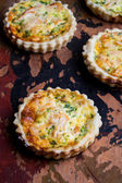 Mini salmon cheese quiches — Stock Photo