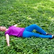 Woman lying on the grass — Stock Photo
