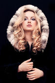 Young woman in fur — Stok fotoğraf