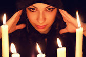 Soothsayer with candles — Stock Photo