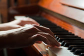 Hands playing the piano — Stock Photo