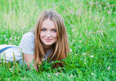 Female laying on grass — Stock Photo