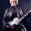 Girl with electric guitar — Stock Photo