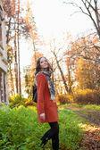 Girl in an orange coat — Stock Photo