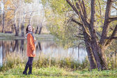 Girl in an orange coat — Stock Photo