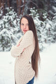Woman in winter forest — Stock Photo