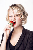 Woman eating a strawberry — Stock Photo